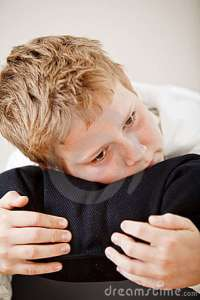 boy-resting-his-head-pillow-12073399
